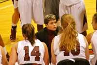 Coach Flamini instructs her team during a timeout. The Lady Quakers sit atop the ODAC standings at 12-1 and 15-3 overall.