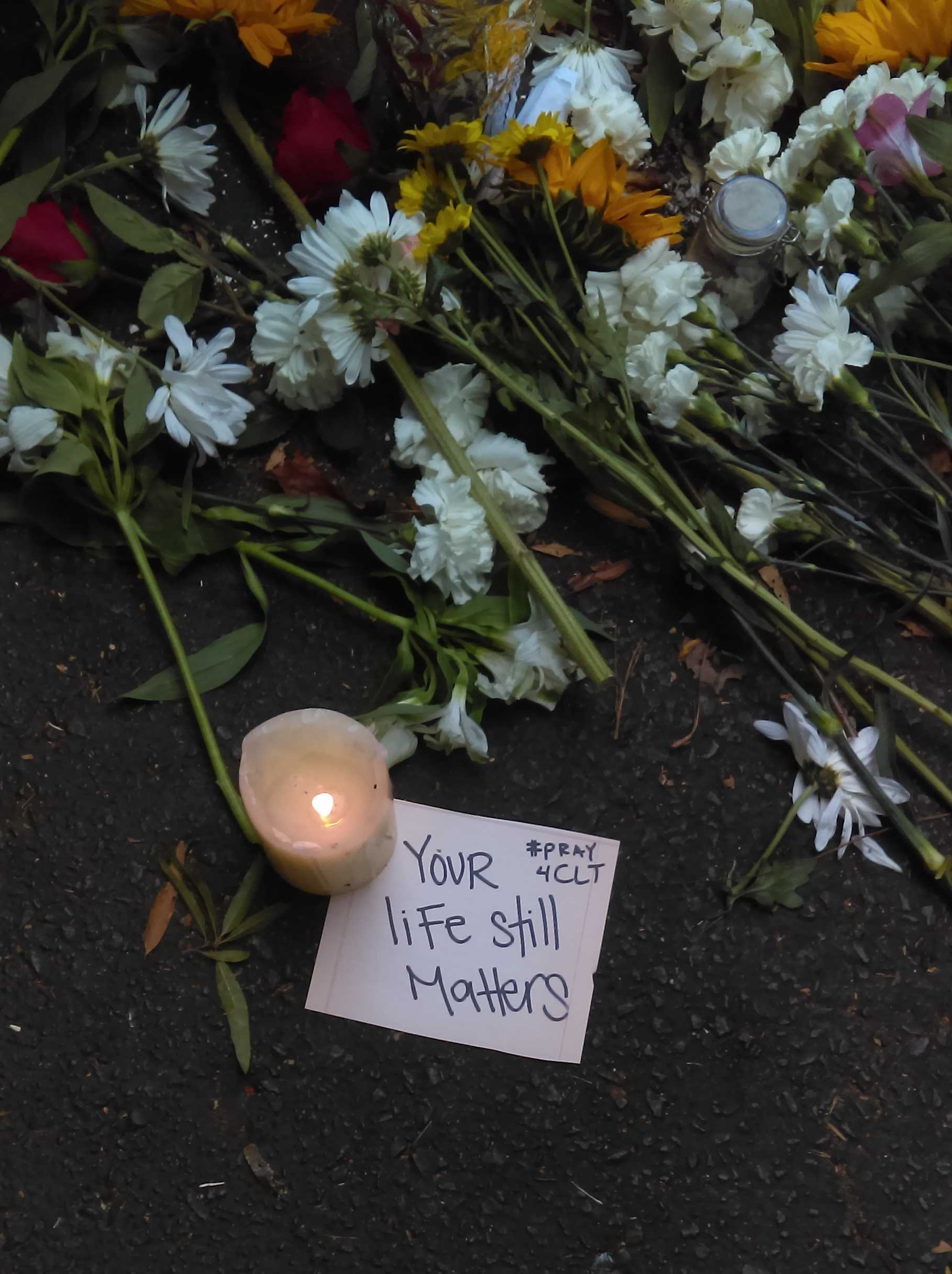 People left flowers and messages near the site where Keith Lamont Scott was killed. Courtesy of Gabe Pollack