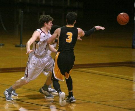 Quaker Men's Basketball team defeat Randolph-Macon