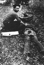 Nelson Johnson beside the murdered Jim Waller. ()