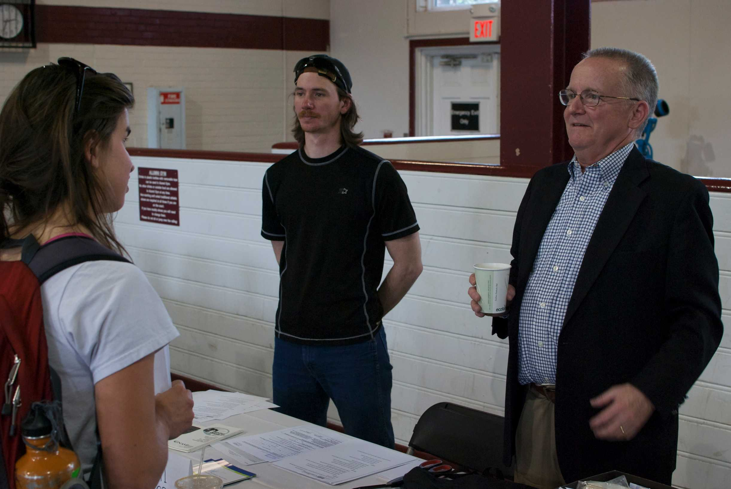 Senior Molly Gibbs learns about the National Alliance of Mental Illness (NAMI) from representative Jack Glenn, president of NAMI Guilford, at the Non-Profit Engagement Fair held in the Alumni Gym on March 16. (Talyor Shields)