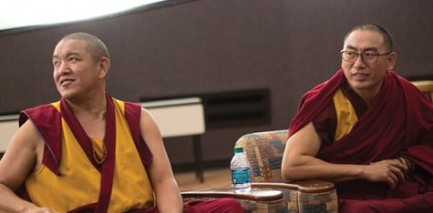 Buddhist Tibetan monks Geshe Gelek and Geshe Sangpo listen to questions from the audience in Joseph M. Bryan Jr. Auditorium.