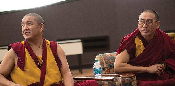 Buddhist+Tibetan+monks+Geshe+Gelek+and+Geshe+Sangpo+listen+to+questions+from+the+audience+in+Joseph+M.+Bryan+Jr.+Auditorium.+