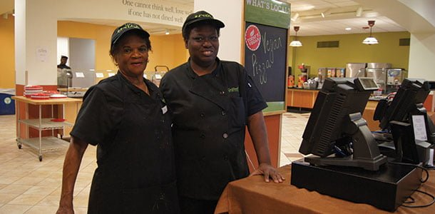 Tina Gilmer and Carlina Smith work in the cafeteria. Gilmer, known amongst students for her grilled cheeses, has been working at Guilford for over twenty years, while Smith started this semester.