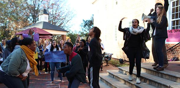 Students chant at the #IntegrityforGuilford rally on Nov. 20, outside of Founders Hall. Following the protests, Board of Trustees members Lionel Johnson and Ester Hall '74 visited campus on Dec. 3 to respond to student organizers' list of demands.