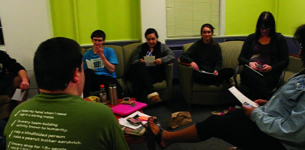 Binford RAs attend their weekly Sunday meeting with Brain Daniel and Kristie Wyatt 08, Wellness Education Coordinator, to discuss campus events and issues
