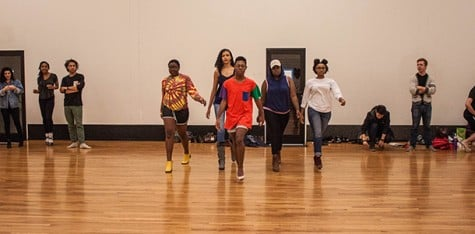 (Top) Fashion show organizer Terry Daniels leads the way with her fellow models, Jhanna Vasser, Lila Jones, Slyvia Shackleford and Celene Warren as they prepare for the upcoming show. (Bottom left to right) Veronica Zambrano- Coffie, Zi Huang and Katie Williams strike a pose during rehearsal.