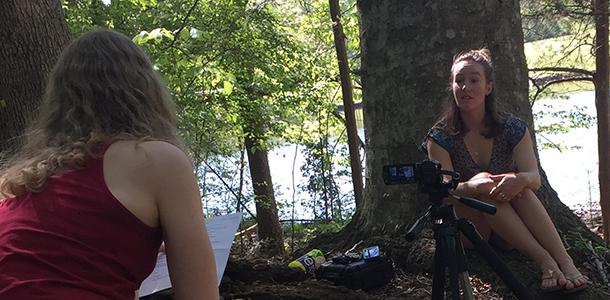 Junior Hannah Brewer-Jensen interviews senior Kelsey Ruehling on camera for the Cape Fear River Basin Studies Program documentary.