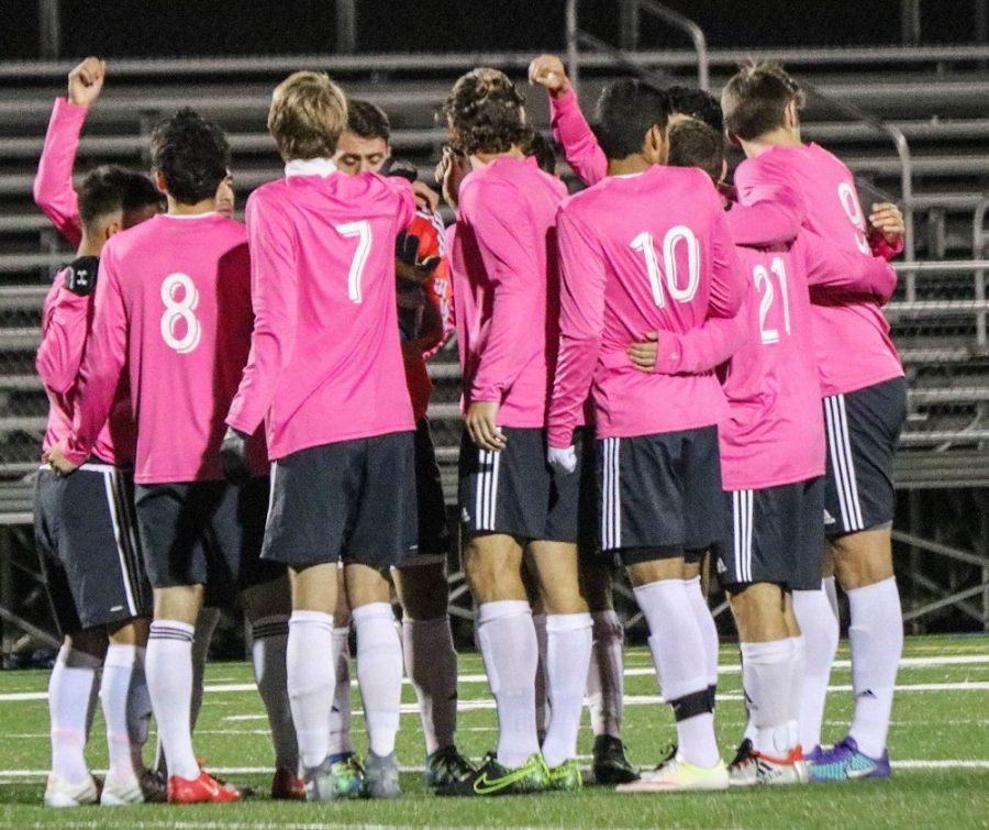 The+men%E2%80%99s+soccer+team+shows+support+for+breast+cancer+awareness+by+wearing+pink+jerseys+in+games+throughout+the+month+of+October.