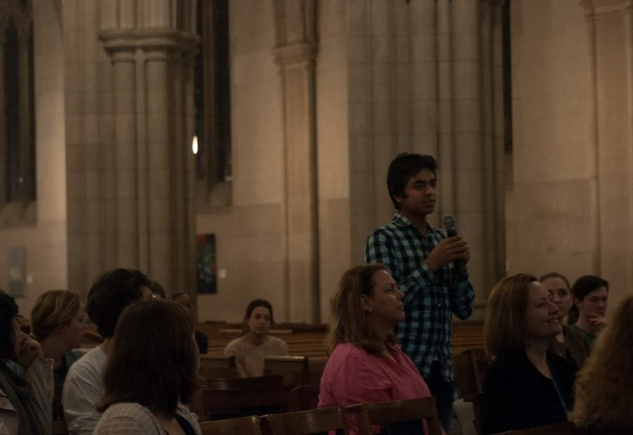 Neale Vaidya, a sophomore at Duke, asks speaker Diya Abdo a question during the Finding Sanctuary Speaker Series at the Duke Chapel in Durham North Carolina on Feb. 7, 2017.