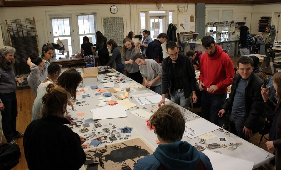 Faculty and students gather in the Hege Cox print shop during the Free Press event on Friday afternoon, Feb. 10, 2017. At least 100 student and faculty participated in the print-making open house. They printed T-shirts, posters and stickers with Black Lives Matter and Feminism is for Everyone. Photo by Julia Martins De Sa/Copyright 2017