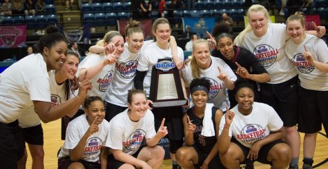 Guilford College women's basketball team poses with the ODAC championship trophy after beating Lynchburg College 59-53. Photo By Andrew Walker 2017