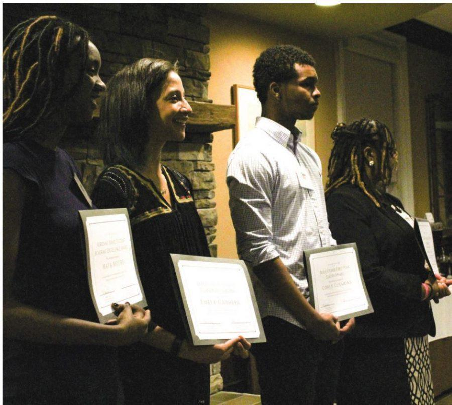 From left to right Maya Moore '20, Emely Cabrera '17, Corey Clemons '20 and Rehshetta Wells '17 receive awards and celebrate Black student achievements at the Journeys in Blackness Banquet on campus that took place on Sunday March 4. // Photo by Nicole Zelniker/Guilfordian