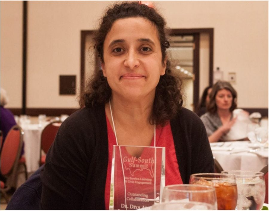 Diya Abdo, associate professor of English, receives the 2017 Outstanding Service-Learning Collaboration in Higher Education Award during the Gulf South Summit conference on Friday, March 24, 2017 in Greensboro, North Carolina. // Photo by Fernando Jimenez/Guilfordian.