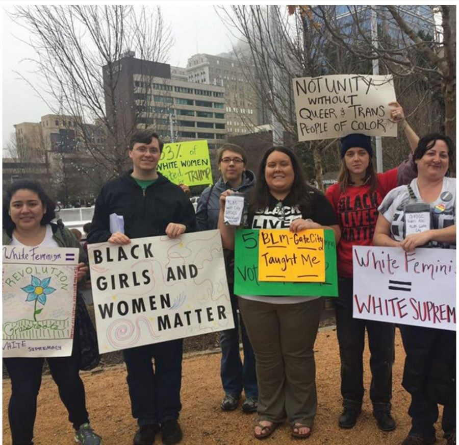 "Supporters and allies of the Black Lives Matter movement collect money for queer and trans women of color during the ""A Day Without Women"" protest that took place on Wednesday, March 8, in Greensboro, North Carolina. // Photo courtesy of Valeria Sosa"
