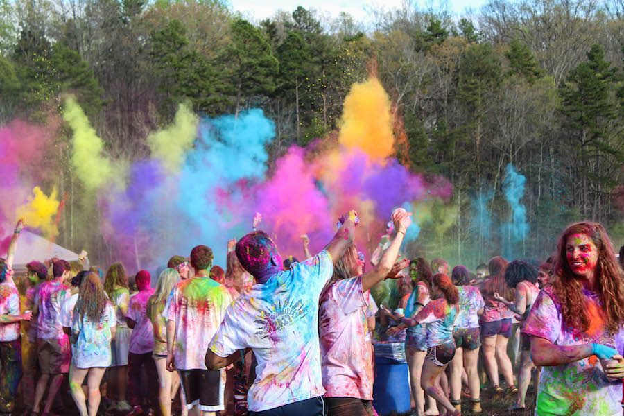 Inspired by the Hindu festival Holi, the Festival of Colors, that celebrates the beginning of Spring, students throw colored powder in the air at the during Colorfest  at the start of Serendipity which took place on Friday Mar. 31, 2017 at the Lake. Photo by Nicole Zelniker/Guilfordian