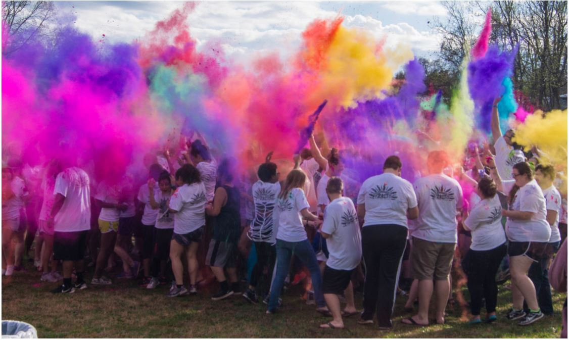 3 Inspired by the Hindu festival Holi, the Festival of Colors, that celebrates the beginning of Spring, students throw colored powder in the air at the beginning of Colorfest which took place on Friday Mar. 31, 2017 at the Lake. // Fernando Jimenez/Guilfordian