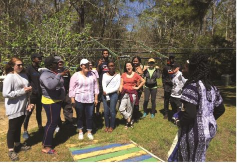 First-year Bonner Scholars learn about the history and culture of the Gullah/Geechee tribe as they listen to Queen Quet. They engaged in volunteer service at the Gullah/Geechee Sea Island Coalition, South Carolina this past spring break. // Photo courtesy of James Shields.