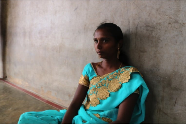 Ramya, who married her uncle at age 14, in her home in Athimoor. Image by Praveena Somasundaram. India, 2017. Pulitzer Center.