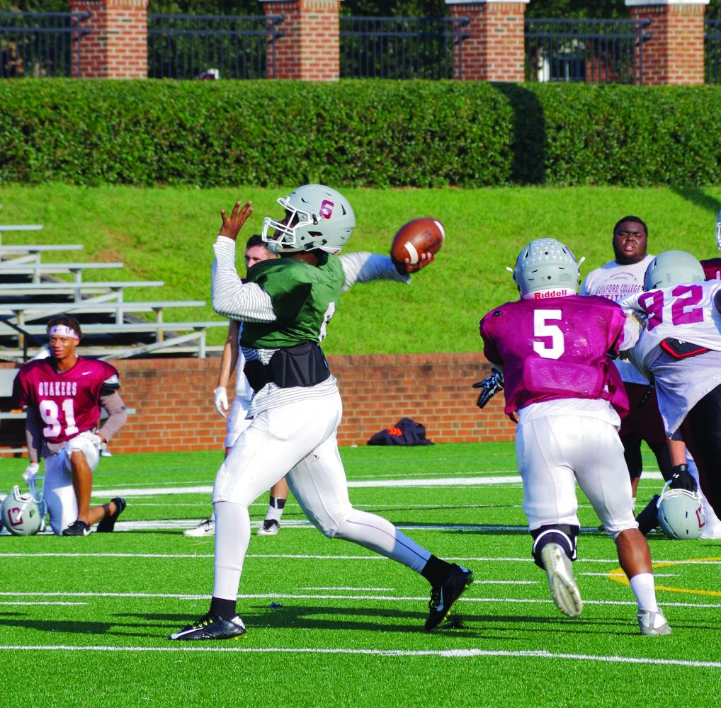 Guilford+College+football+senior+quarterback+Karsten+Miller+passes+a+ball+during+practice+on+Sept.+20%2C+2017.+Miller+has+1109+passing+yards+and+10+passing+touchdowns+through+three+games.+Photos+By+Andrew+Walker+2017%2FThe+Guilfordian