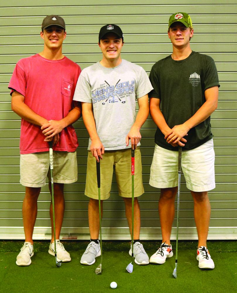 "Members of the Guilford College men's golf team Kell Graham '20, left, Zach Evens '20 and Josh Hill '19 pose for a portrait on Wednesday, Sept. 20, 2017. The three golfers are currently leading the conference with Hill playing an average of 69.3, Evans an average of 69.5 and Graham an average of 70.0. The men's golf team has been ranked fourth in the nation by the NCAA Division III Bushnell magazine ""Golfweek."" //Photo by Abigail Bekele/The Guilfordian"