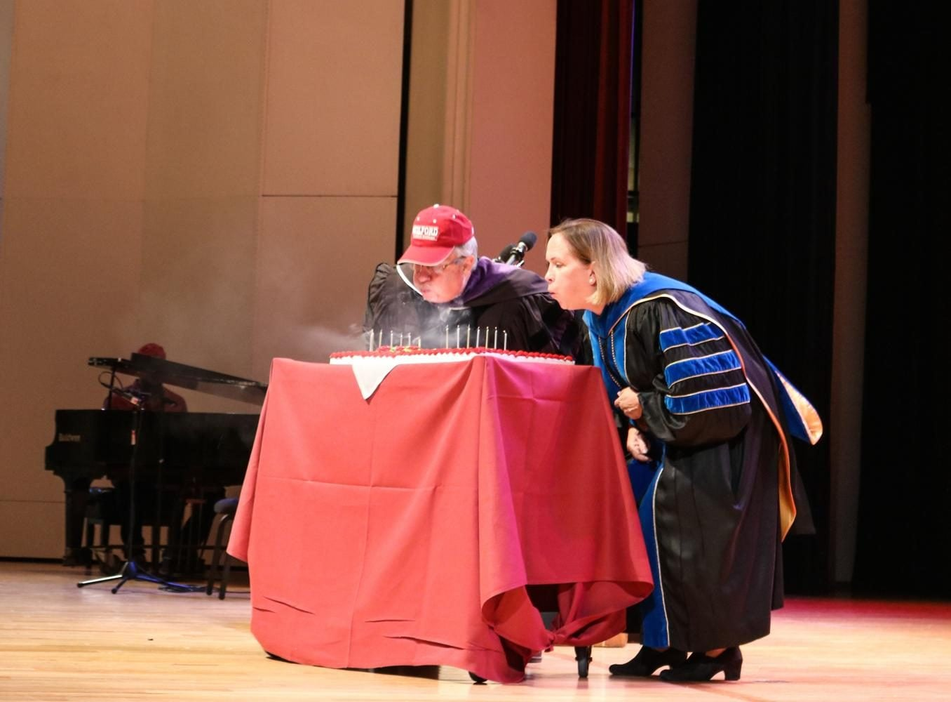 Left to right Edward C. Winslow III and President Jane K. Fernandes blow out candles in celebration of Guilford College's 180th birthday. // Photo by Fernando Jimenez/The Guilfordian