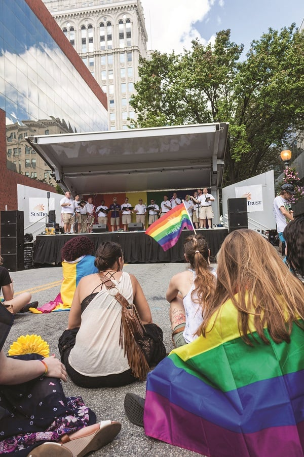 """The Triad Pride Men's Chorus perform a cover of Katy Perry's """"Firework"""" for the crowd of Pride supporters.// Photos by Fernando Jimenez/The Guilfordian"""