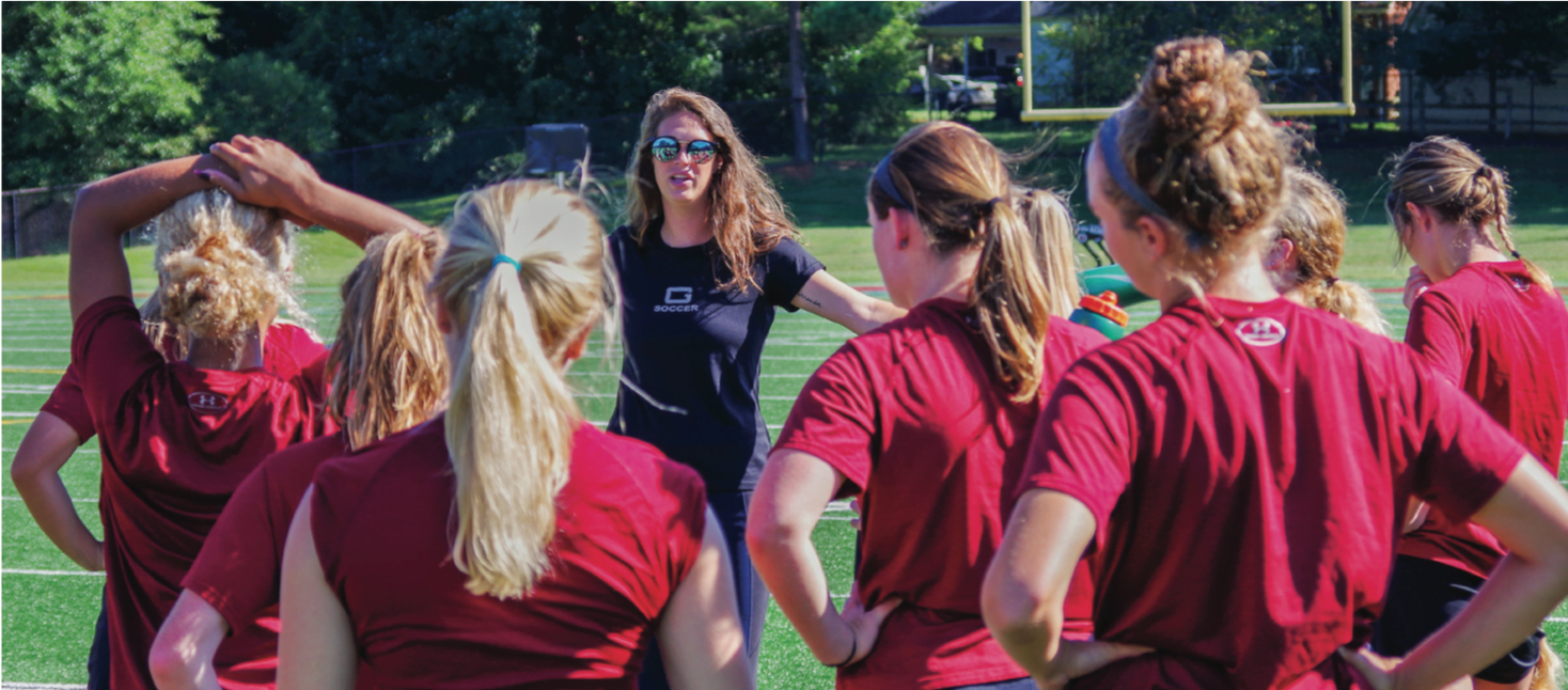 Guilford women's soccer Assistant Coach Anna Smithers talks to the team at the start of practice in Greensboro, N.C. on Saturday, Sept. 9, 2017. This is Smithers' second year as an assistant coach where she will work with new Head Coach Stephanie Webb.//Photo By Andrew Walker 2017/The Guilfordian