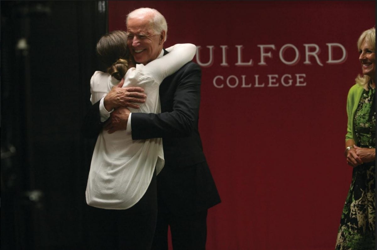 Courtney Gardner '18 hugs Vice President Joe Biden during the small student session that happened before the main event. Students of Guilford College's Political Science department got a chance to meet Jill and Joe Biden before they took the Coliseum stage.// Photos by Abigail Bekele/The Guilfordian