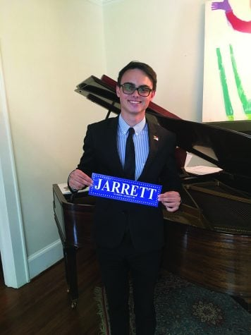 Sophomore Josh Jarrett poses with a bumper sticker from his campaign.  // Photo courtesy of Josh Jarrett