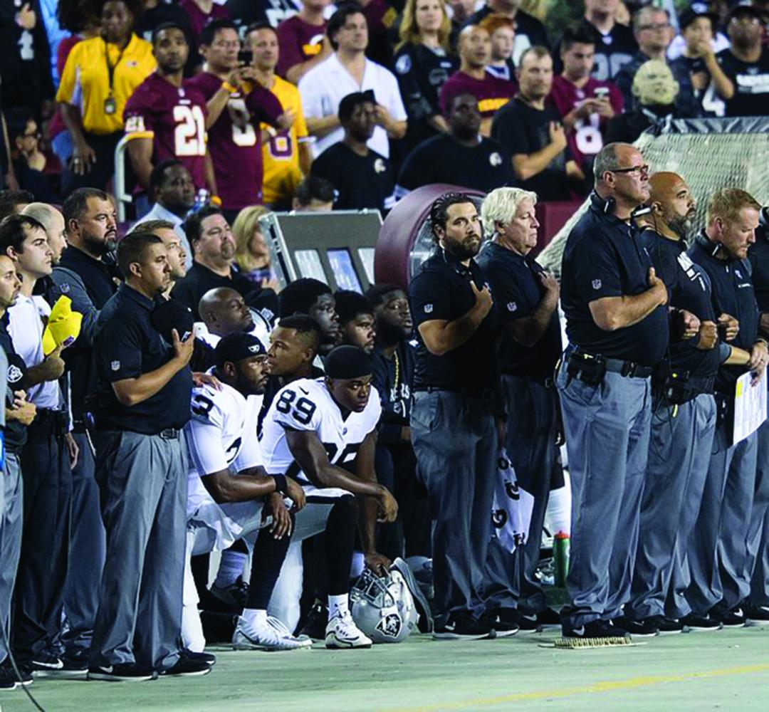 NFL players kneel during the National Anthem as a form of protest against police brutality.There were many teams that particpated in this protest. // Photo courtesy of Wikimedia Commons