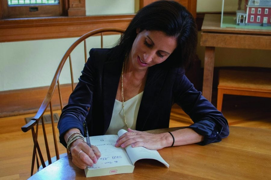 """Lisa Genova, author of """"Still Alice,"""" signs copies of her book at the Q&A session held in the Carnegie Room in Hege Library on Wednesday, Oct. 25, 2017.// Photo by Julia Martins de Sa/The Guilfordian"""
