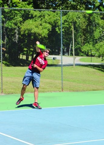 Guilford College men's tennis first-year Kane Mills practices on Tuesday, Oct. 3, 2017. //Photo by Abigail Bekele/The Guilfordian