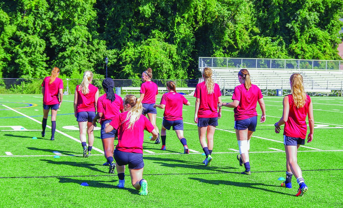 Guilford College women's soccer team stretches at the start of practice on Appenzeller Field in Greensboro, North Carolina on Sept. 9, 2017.//Photo By Andrew Walker/The Guilfordian