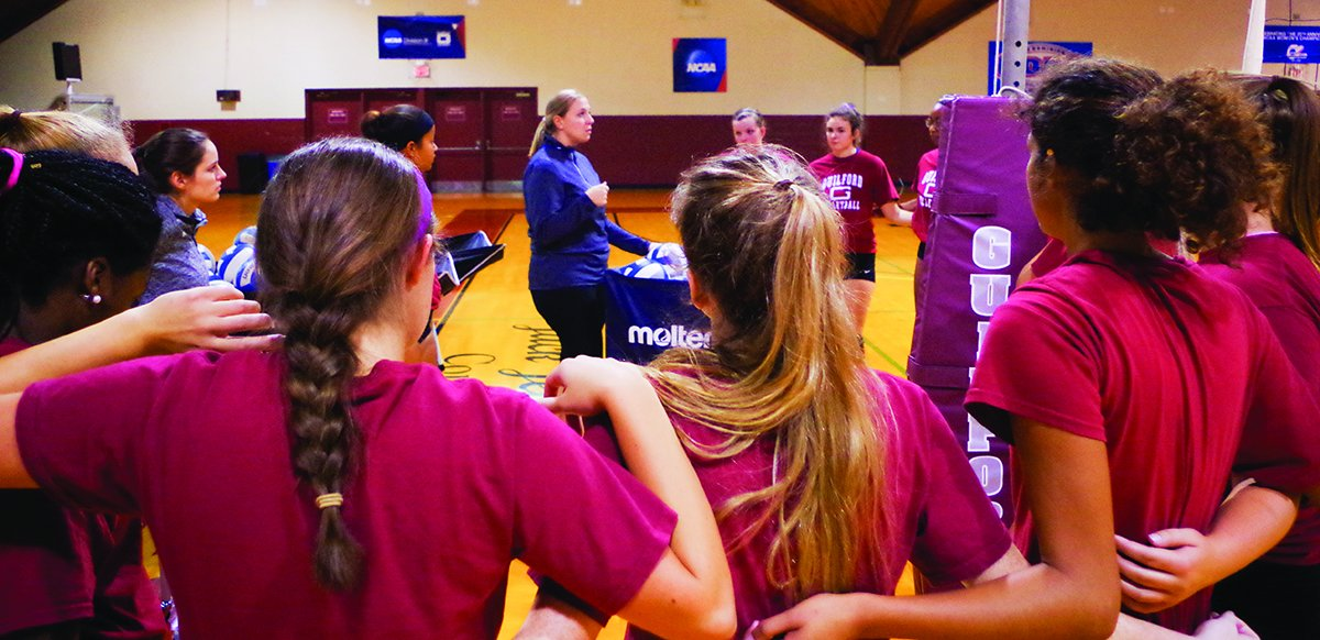 Guilford College volleyball head coach Emily Gann (center) talks to the team during practice.The Quakers return 13 players from a fifth place finish last season and were ranked sixth in the ODAC Preseason Poll.//Photo By Andrew Walker/The Guilfordian