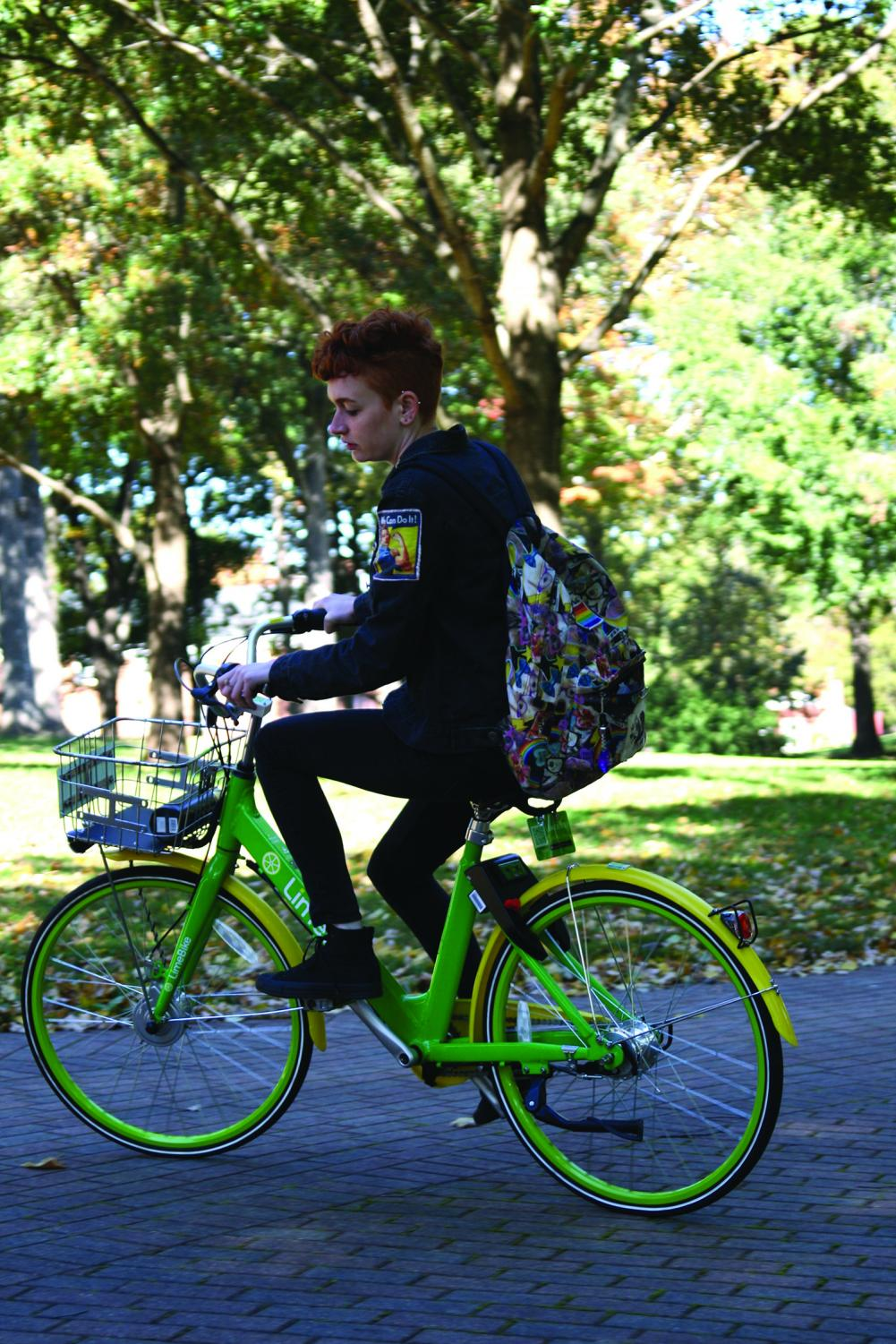 Early College student Sydney Pierce rides a LimeBike for the first time on Oct. 27.//Photo by Hannah Shoemaker/The Guilfordian