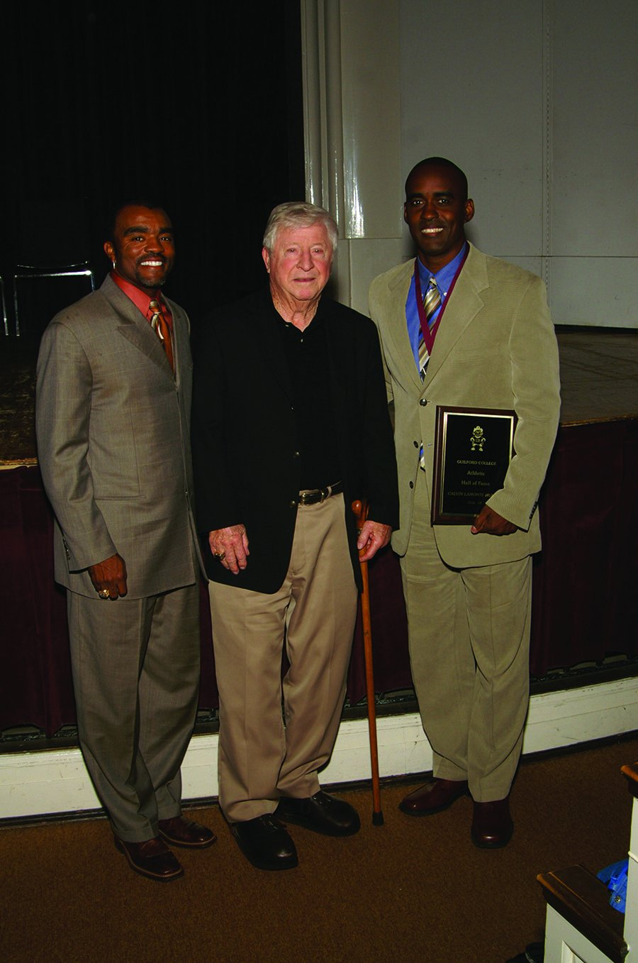 Former athletic director Herbert Appenzeller (center) stands with former Major League Baseball player Tony Womack '92 (left) and Guilford College football quarterback and current Associate Professor of Sport Management Calvin Hunter '92. Appenzeller joined Womack and Hunter as they were inducted into the 2006-2007 Guilford College Athletics Hall of Fame.//Photo courtesy Guilford Athletics.