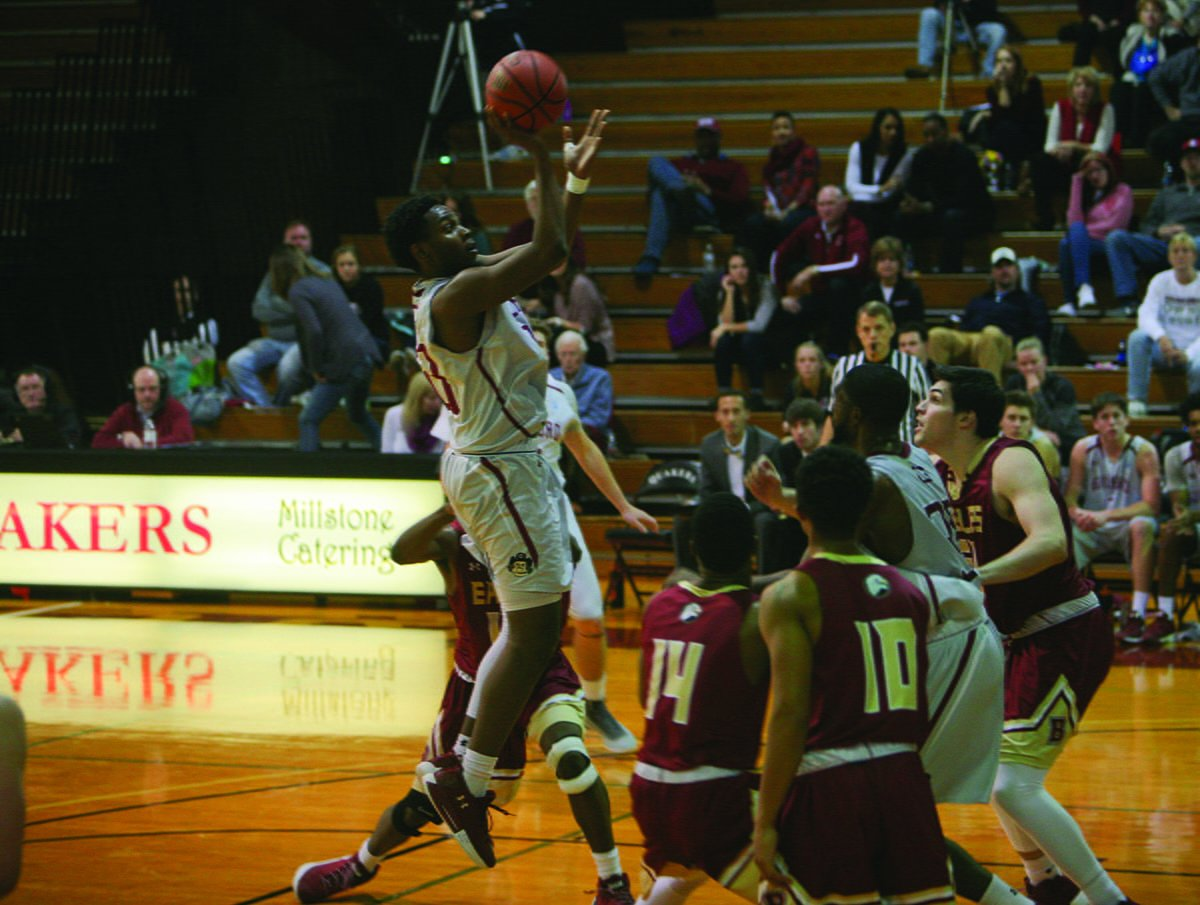 Junior forward Marcus Curry attempts a floater against Bridgewater College on Saturday, January 13, 2018 in the Ragan-Brown Field House. Curry scored nine points in the 67-66 loss to the Eagles. // Photo By Andrew Walker/The Guilfordian