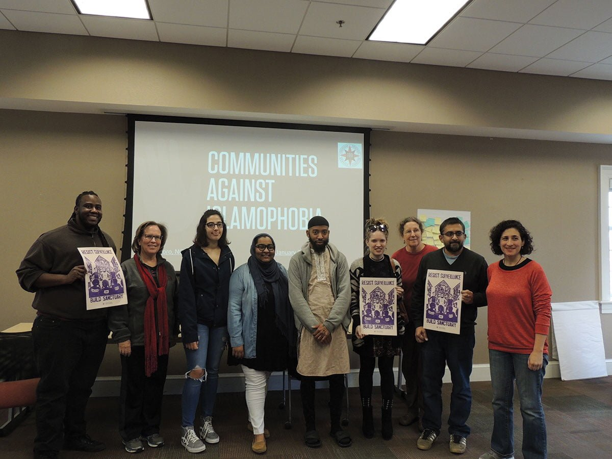 Attendees of the Communities Against Islamophobia event pose for a picture on Saturday, Jan. 27, 2018.//Photo by Abigail Abantohollans/The Guilfordian