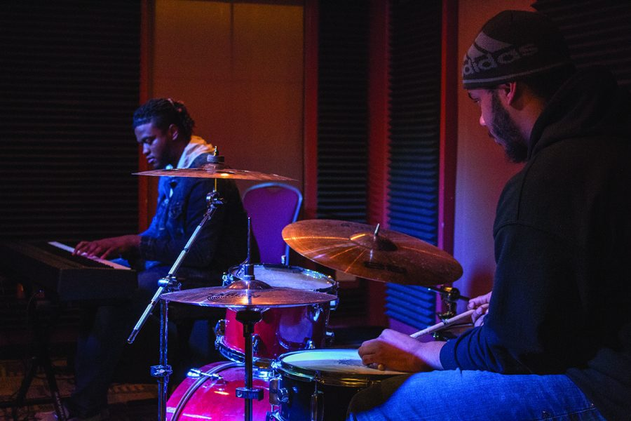 Gregory Stockton, left, and Troy Taylor play the keyboard and drums respectively at the Praise and Worship Night in the Community Center.//Photo by Julia Martins de Sa/The Guilfordian