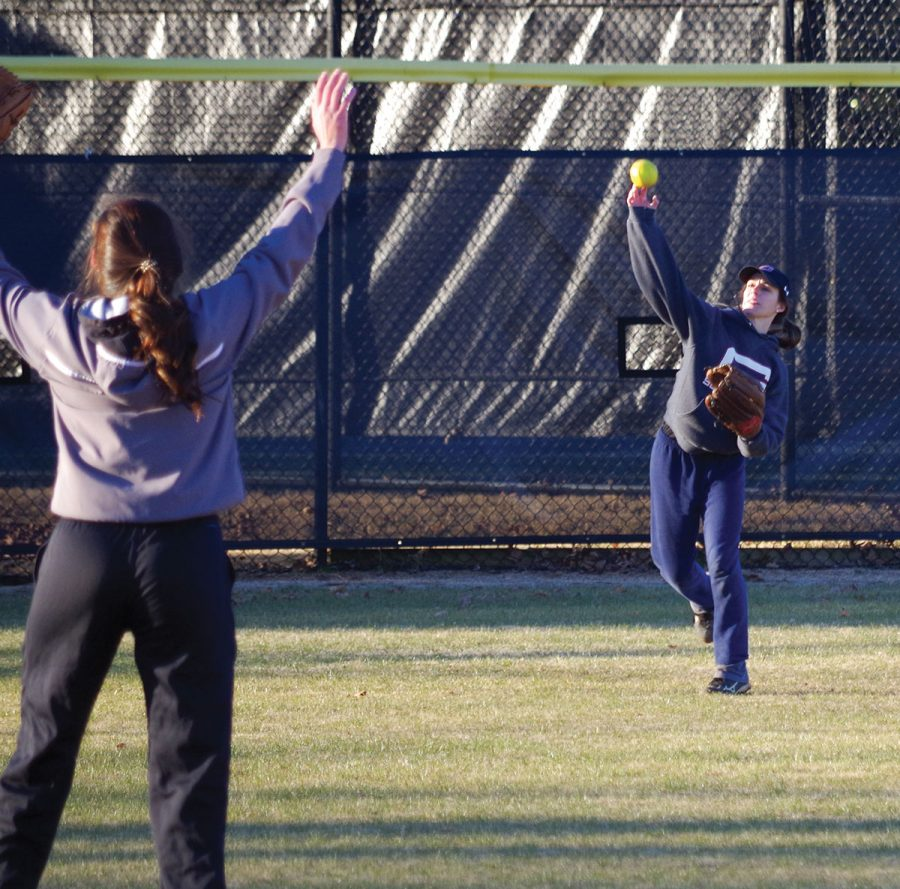 Guilford College softball sophomore outfielder Kayli Blankenship throws the ball to sophomore infielder Sarah Adams at practice on Feb. 2, 2018.//Photo By Andrew Walker/The Guilfordian