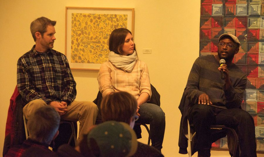 Charlie Tefft (left), Katy Collier and Antoine Williams discuss building a career in their field and the struggles they face in their work in the Hege Library Art Gallery on Wednesday, Jan. 28, 2018.//Photo by Ezra Weiss/The Guilfordian