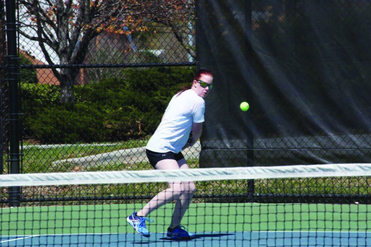 Sophomore Megan Kimpel begins her first season on the women's tennis team. Guilford only had two returners from last season./Photo Courtesy of John Bell, Touch A Life Photography