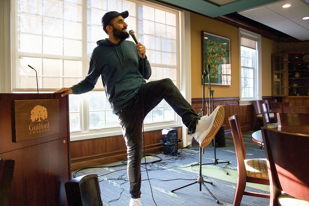 Standup comedian Danish Maqbool performed a comedy routine on Tuesday, April 10, in the Gilmer Room in Founders Hall. // Photo by Julia Martins de Sa/The Guilfordian