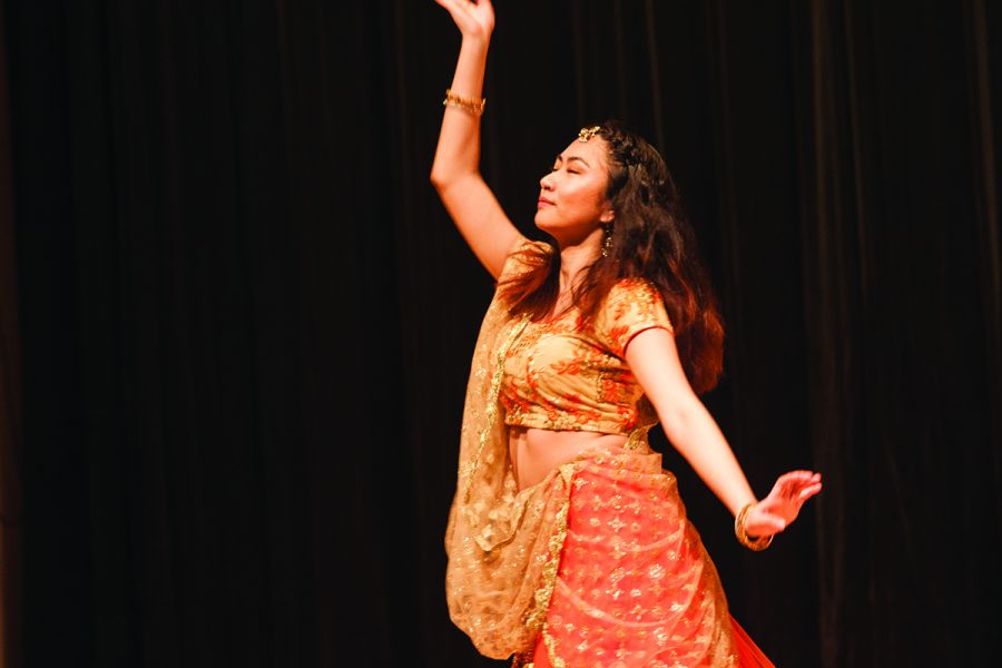 First-year+Nima+Lama+performs+a+traditional+Nepalese+dance+during+an+intermission+act+of+the+international+fashion+show.+The+event+featured+diverse+student+models+and+performances+throughout+the+night.%2F%2FPhoto+by+Fernando+Jim%C3%A9nez%2FThe+Guilfordian
