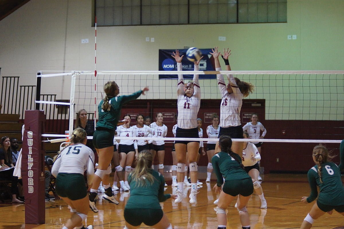 Guilford College junior setter Tina Eucker (11) and junior middle blocker Michaela Allred (16) attempt to block a hit by Methodist University sophomore outside hitter Megan Andrews on Sept. 5. // Photo courtesy of John Bell/Guilford College Athletics