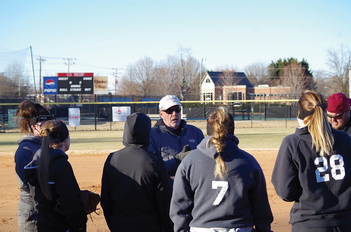 Guilford College softball head coach Dennis Shores talks to his team during practice at Haworth Field. // Photo By: Andrew Walker/The Guilfordian