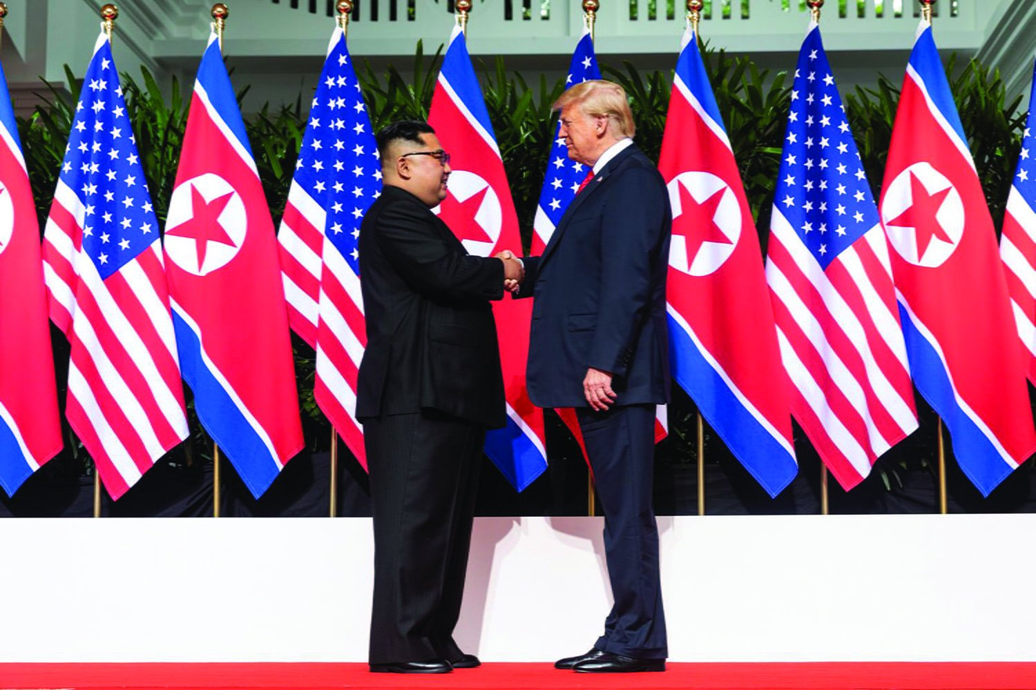President Donald Trump shakes hands with North Korean Supreme Leader Kim Jong-un on June 12,, 2018, in Singapore. This is the first time a U.S. president has met with a North Korean ruler. // Photo courtesy of Wikimedia Commons