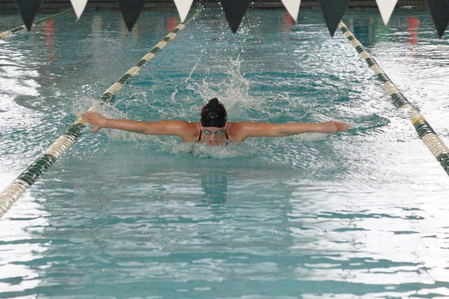 Junior+Carolyn+O%E2%80%99Halloran+swims+in+the+100-yard+butterfly+race+at+a+meet+against+Greensboro+College.%2F%2FPhoto+Courtesy%3A+John+Bell%2FTouch+A+Life+Photography%2F%0A