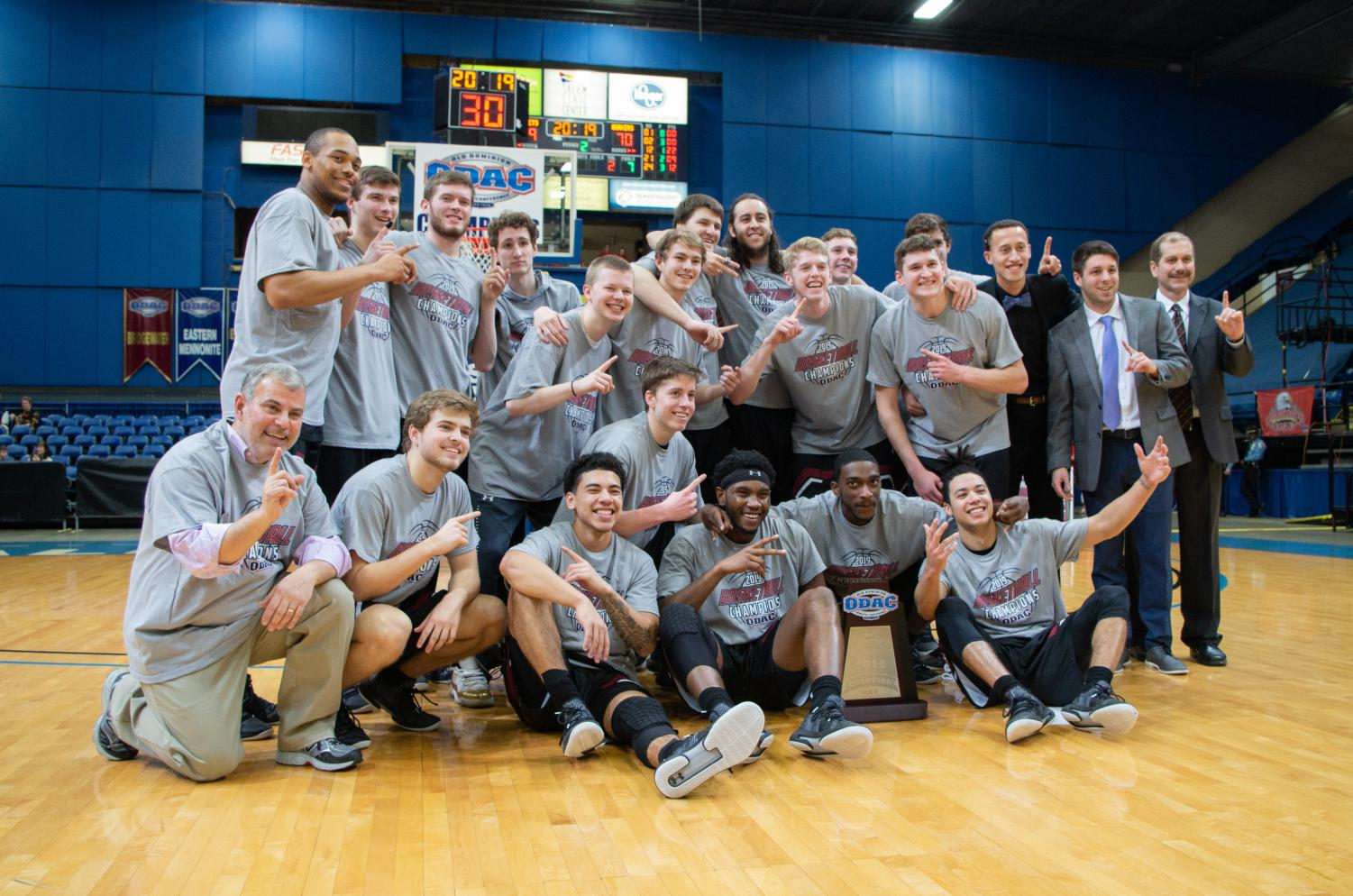 Guilford College men's basketball poses after winning the ODAC Tournament Championship 70-59 over Randolph-Macon College.